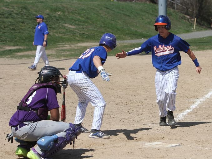 Patrick Ortiz from Yonkers High School, heads home to score on a balk, during the Yonkers City Championship game against Lincoln High School at Fleming Field, April 18, 2015. Lincoln beat Yonkers, 4-3.