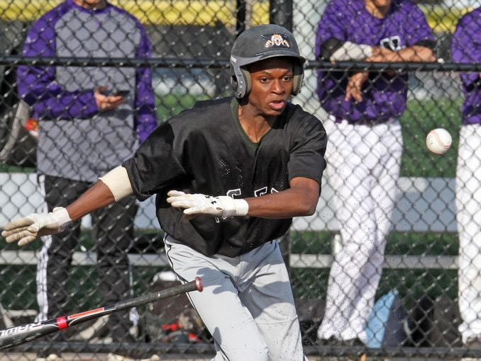 Miles Haughton lays down a bunt as Mamaroneck defeated New Rochelle 2-1 in nine innings in a varsity baseball game at City Park in New Rochelle April 21, 2015.