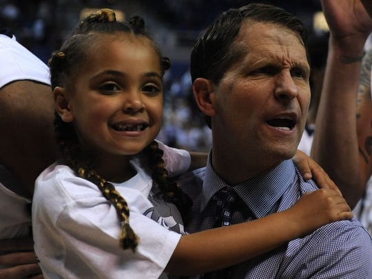 Wolf Pack coach Eric Musselman, right, and his daughter, Mariah, celebrate after Nevada's win Wednesday.