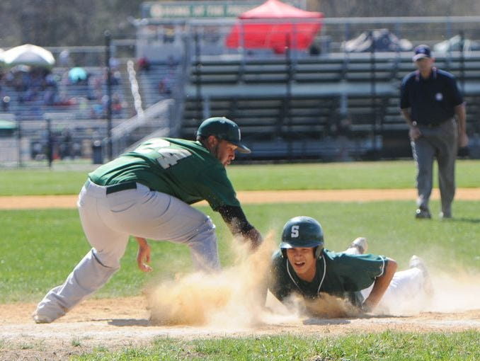 Spackenkill High School's Josh Rosario slides back to first base during a May 2, 2015 game against Franklin D. Roosevelt.