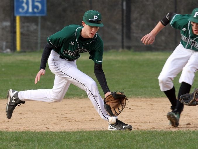 Pleasantville's John Carlo Angiolillo (7) backs up Brendan O'Neill (9) as he catches a ground ball during baseball game at Eastchester High School on March 31, 2016. Eastchester defeated Pleasantville 2-1.
