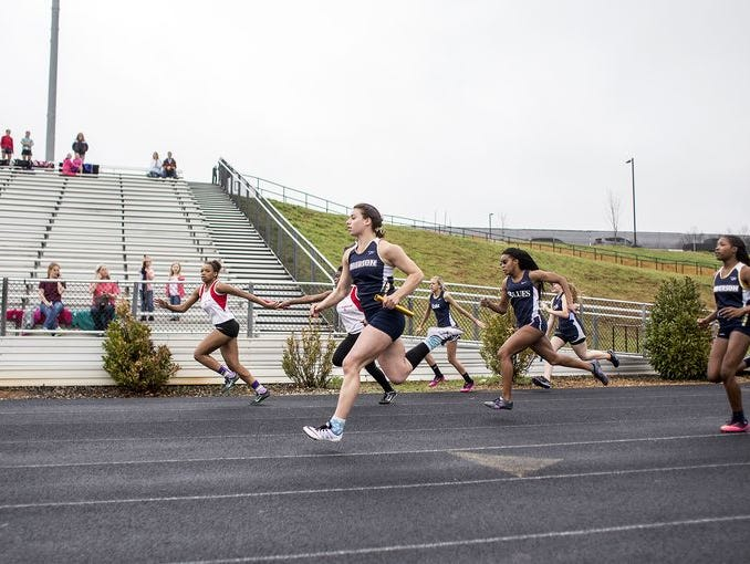 Sprinters compete in last year's Buncombe County track meet.