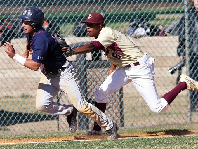 From right, Iona's Tyler Castaing (8) tags out Stepinac's Kendell Luquis (21) after he was caught in a rundown between 3rd and home during a baseball game at Iona Prep in New Rochelle April 28, 2015. Iona won the game 15-6.