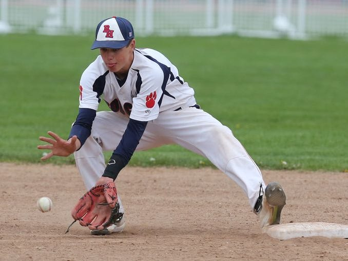 Nick Schaefer (2) of Bryam Hills catches a ground ball at second base for the out during baseball game against Tappan Zee High School at Byram Hills High School in Armonk on April 29, 2016.
