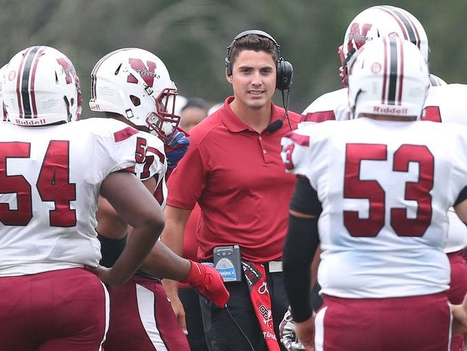Nyack defeated Byram Hills 54-34 at Byram Hills High School on Sept. 12, 2015. Coach Mike Ramponi (center) resigned from Nyack and was named the athletic director at Ardsley.