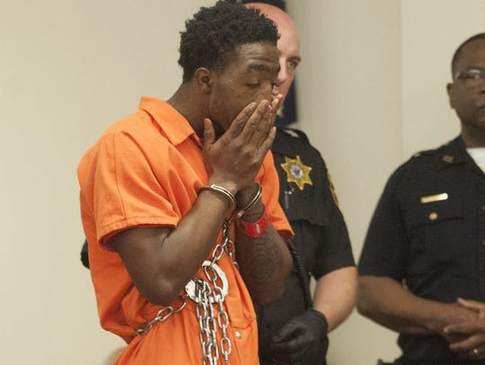 Raquan Handon, then a Triton Regional High School students, reacts during a May 2016 arraignment hearing.
