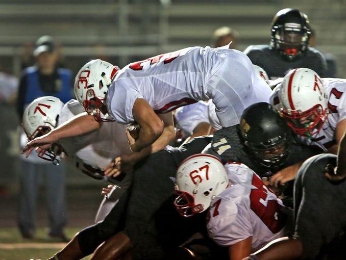 Titus McCoy (30) will be a senior at Center Grove.