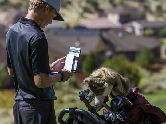 Pine View's Jaden Milne looks at his scorecard during a Region 9 tournament. Milne is excited to have Brooks Bergeson as the new Panther head coach.