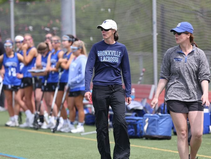 Bronxville head coach Sharon Robinson (center) roams the sidelines next to assistant coach Jackie Pierce (right) during a game against Somers at Somers High School on May 14th, 2016.