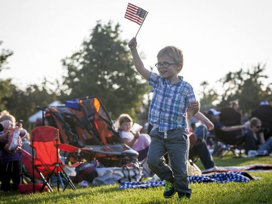 A boy with a flag is among those attending a past Independence