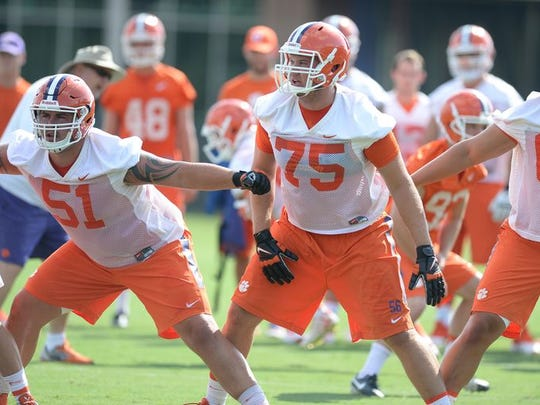 Clemson linemen Taylor Hearn (51) and Mitch Hyatt (75) will anchor the left side of the Tigers' offensive line.