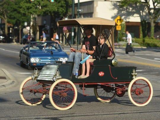 A 1902 Rambler slowly rolls down Woodward.