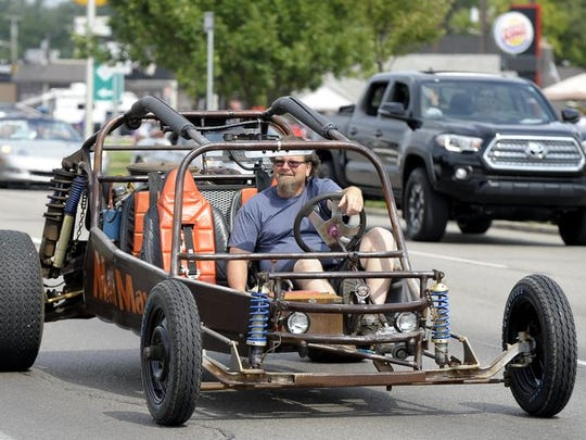 A Mad Max dune buggy drives south on Woodward.