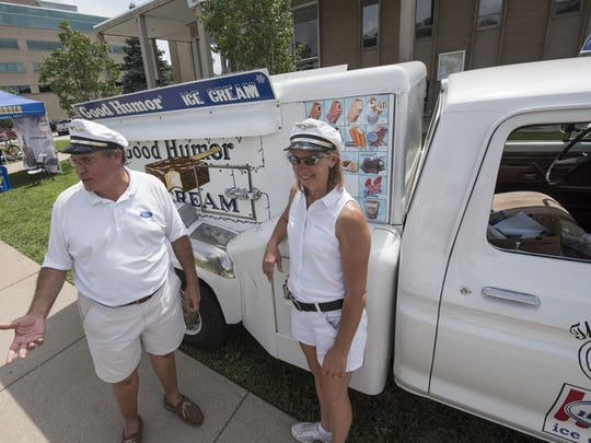 Mike and Sue Berardi of Canton sell ice cream in front of their working 1973 Ford F250 ice cream truck on Nine Mile in Ferndale.