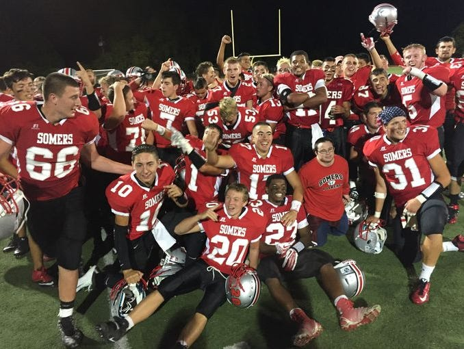 The Somers team celebrates a 38-21 win over Yorktown on Sept. 25, 2015. Senior Matt Pires was named the Varsity Insider Week 2 Player of the Week. He and the Tuskers will visit Yorktown this weekend.