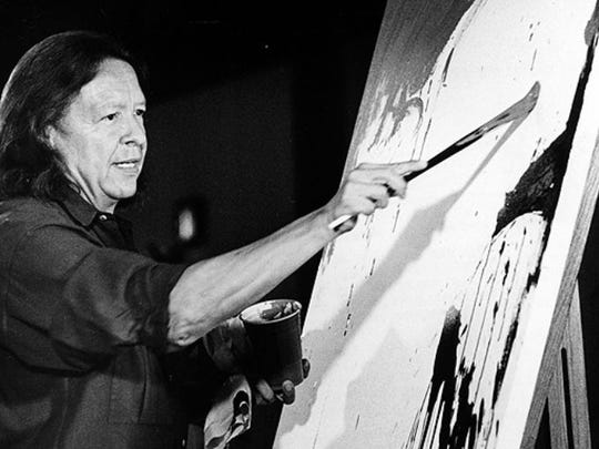 Fritz Scholder giving a painting demonstration at the