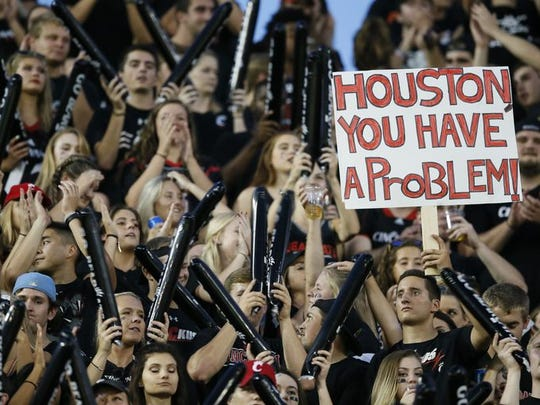 Cincinnati Bearcats fans cheer on the team in the first quarter during the AAC college football game between the Houston Cougars and the Cincinnati Bearcats, Thursday, Sept. 15, 2016, at Nippert Stadium in Cincinnati.