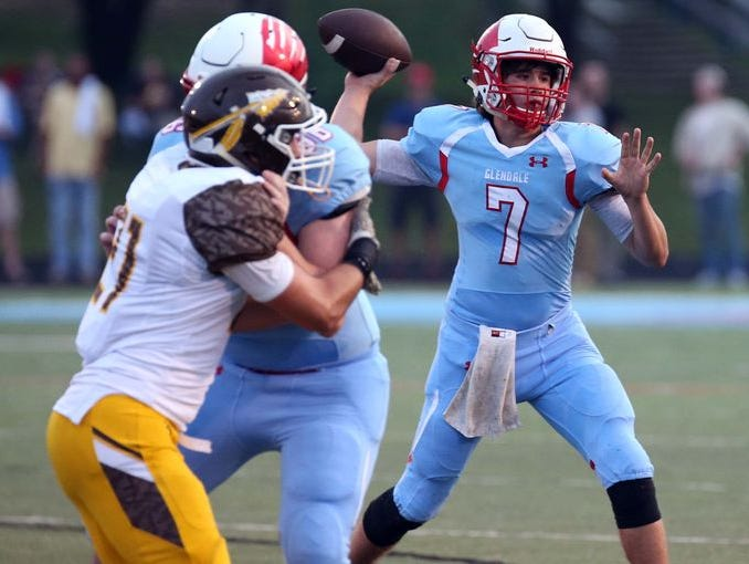 Glendale junior quarterback Alex Huston (7) threw five touchdown passes in the Falcons' 40-20 win over rival Kickapoo Thursday.
