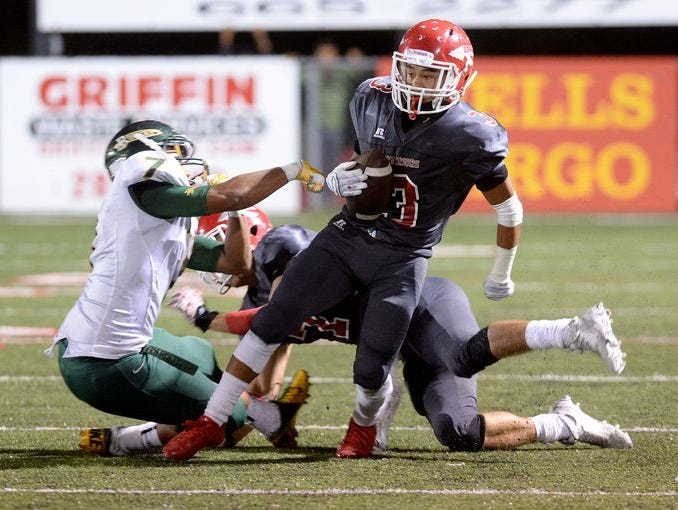 Erwin's Kealin Goode fights for yardage during last year's game between the Warriors and Reynolds.