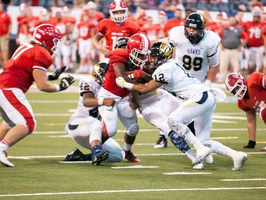No. 12 Larry Tracy makes a tackle against Plainfield.