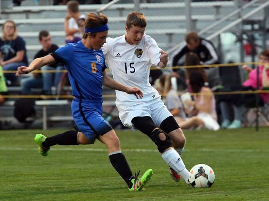 River View junior Zeke Aronhalt and Philo sophomore Dawson Saunders battle for control of the ball Tuesday night.