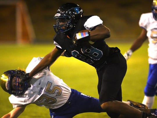 North Valley's Dajon Moore runs against Reed on Oct.