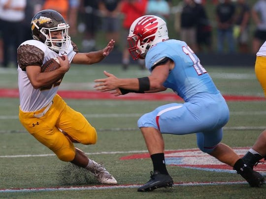 Linebacker Kyle Doran, right, and the Glendale Falcons host Ozark on Friday in the Class 5 football playoffs.