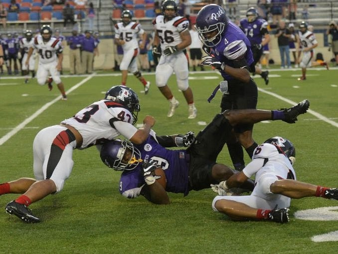 Parkway's Nick So'oto (56) moves in to assist with a tackle.