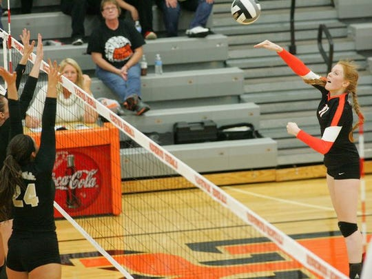 Ridgewood's Autumn Brown hits the ball over the net