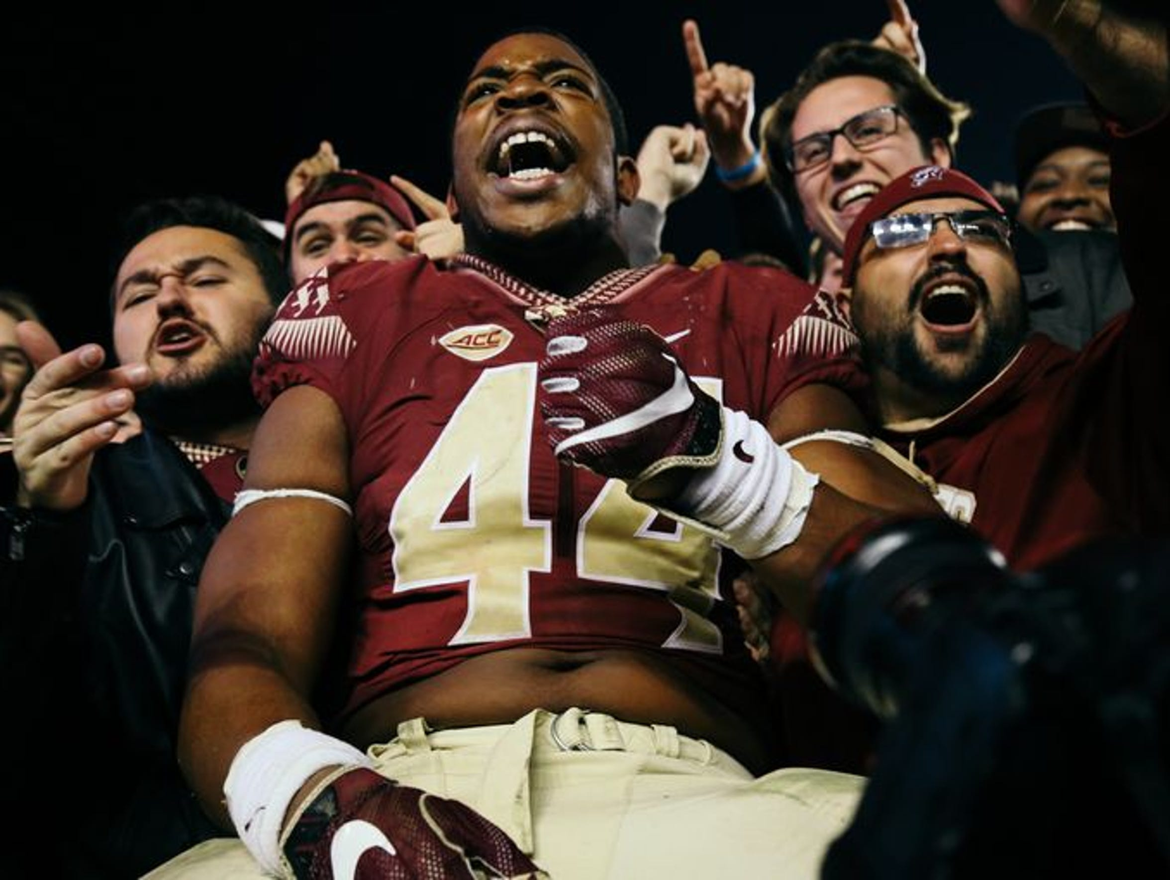 Demarcus Walker celebrates after FSU beat Florida 31-13.
