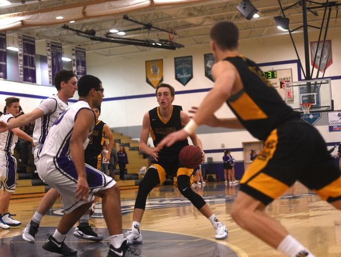 Galena's Moses Wood looks to pass against Spanish Springs last month.