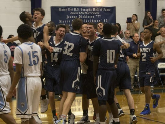The Ranney School players celebrate an impressive 58-56