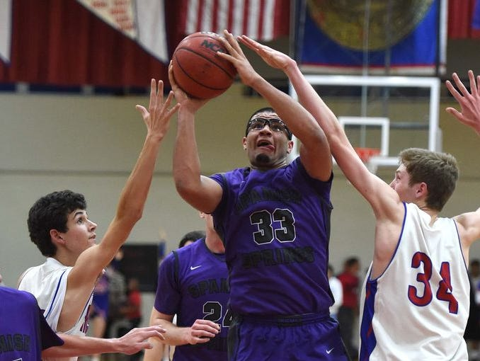 Spanish Springs senior Marcus Loadholt (33) goes up for a shot against Reno on Tuesday