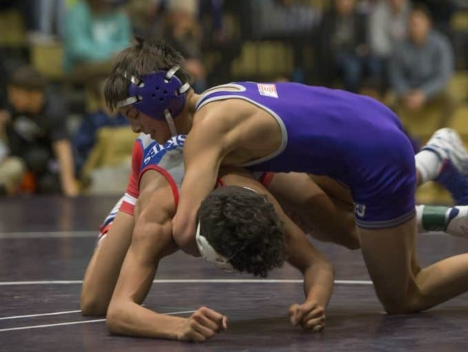 Spanish Springs freshman Anthony Sissom (blue) competes against Reno last month. The state wrestling tournament begins Friday at Spanish Springs.