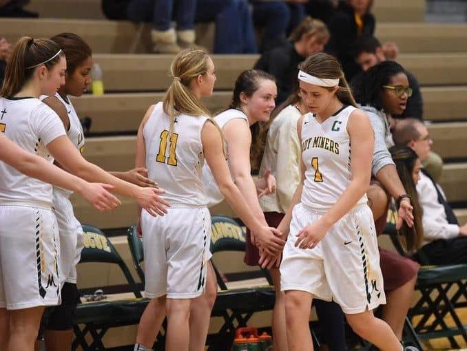Bishop Manogue senior Katie Turner slaps her teammates hands after a game this season.