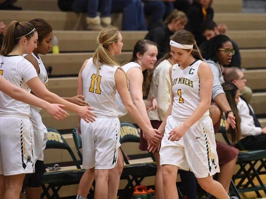 Bishop Manogue senior Katie Turner slaps her teammates hands after a game this season.