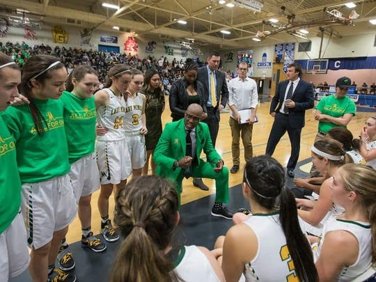 Bishop Manogue coach Carlnel Wiley talks to the team during a time out Saturday against Reno