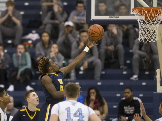 Toms River North Jaden Rhoden go up for a layup against