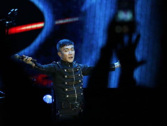 Journey lead singer Arnel Pineda works the crowd of