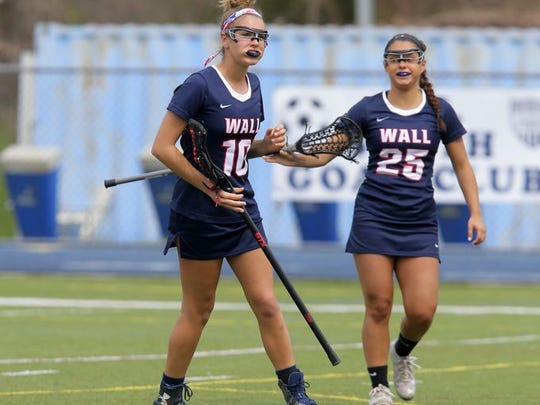 Wall's Kerry Wren and Alexa Sirchio celebrate a goal during the Wall versus Middletown South girls lacrosse game on April 13, 2017