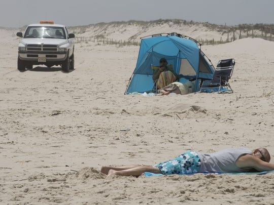 New Jersey State Park Police guard the beach border