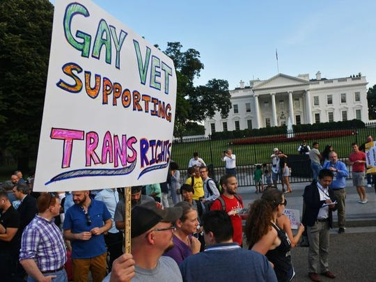 "Protesters gather in front of the White House on July 26, 2017, in Washington, DC. Trump announced on July 26 that transgender people may not serve ""in any capacity"" in the US military, citing the ""tremendous medical costs and disruption"" their presence would cause."