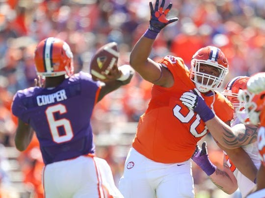Dexter Lawrence (90) pressures quarterback Zerrick Cooper during Clemson's Spring Game last April.