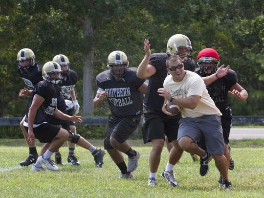 The Southern Regional football team conducts a drill