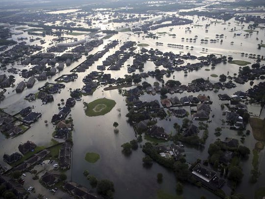 Floodwaters from Tropical Storm Harvey surround homes