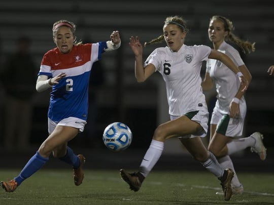 Wall's Amy Paternoster battles with Senecas Alyssa Fox for ball during second half action. Wall Girls Soccer vs Seneca in NJSIAA Group III state semifinal at Toms River North on November 15, 2016.