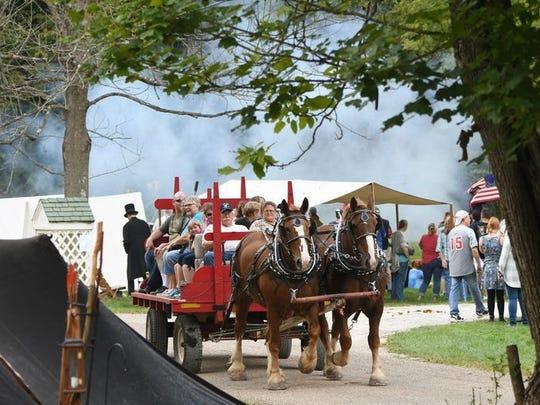 Visitors enjoy a wagon ride at Malabar Farm during Heritage Days in 2017.