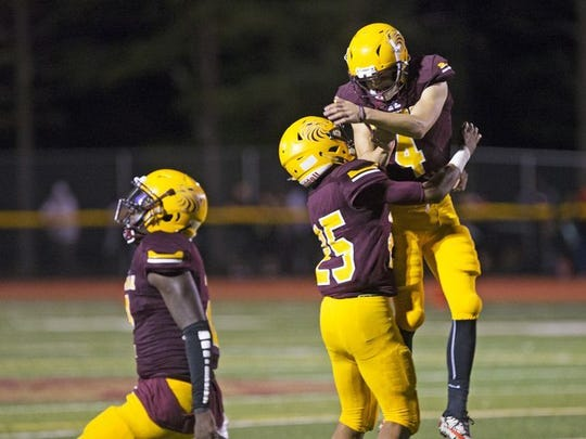 Kicker Shane Black celebrates with teammate Kavon Chambers