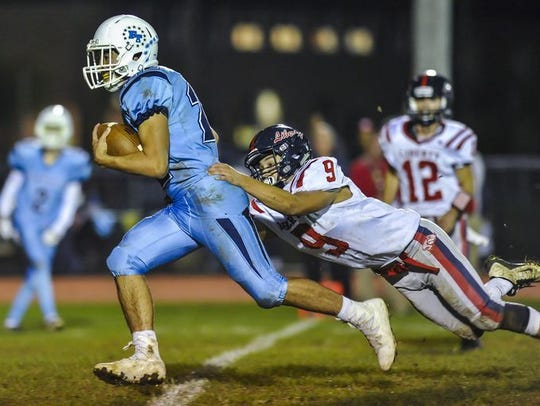 Freehold Township's Artie Bader makes a catch in front