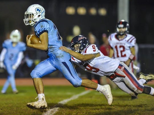 Freehold Township's Artie Bader makes a catch in front of Jackson Liberty's Jimmy Harley during a game in Freehold on Oct. 13, 2017.